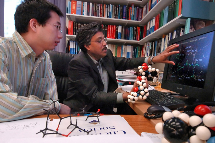 Professor Arun Ghosh and his student.
